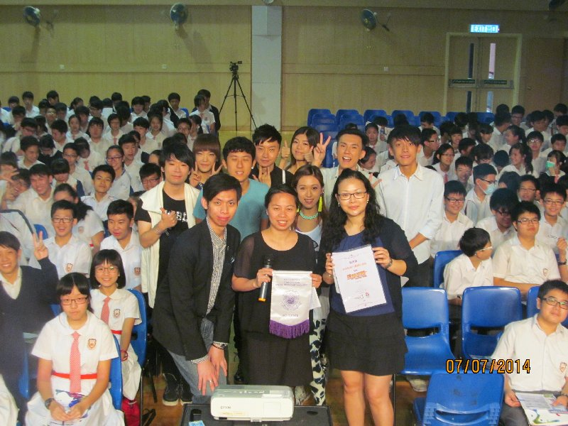 Our assistant principal, Miss Leung Pui Fan, is taking a group photo with all the teenage singers, together with all the S1-S2 audience.