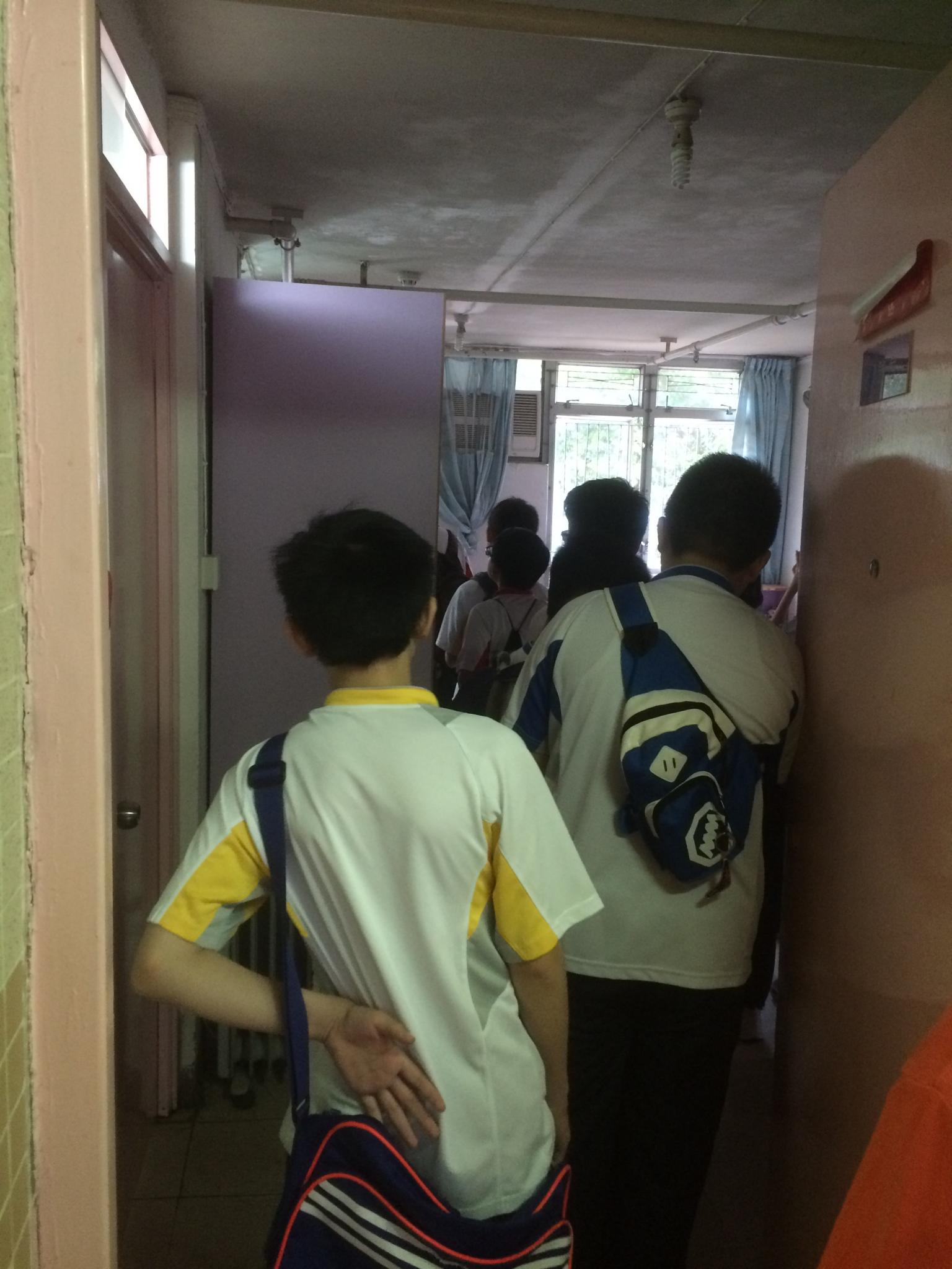 Students are visiting the residents' bed rooms.
