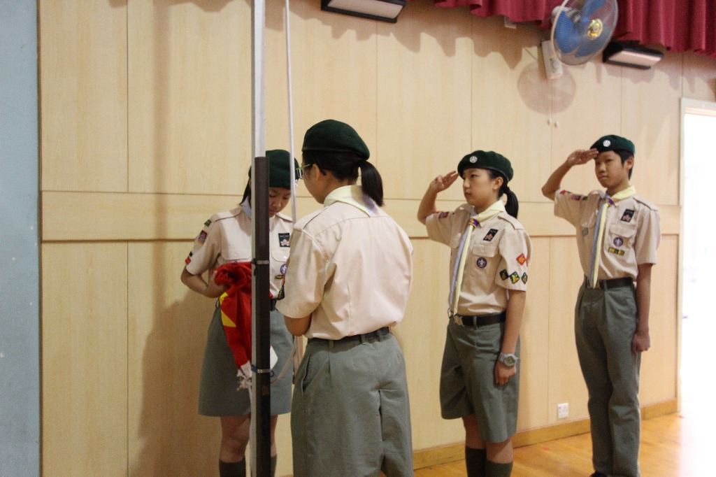 Our scout team was raising the national flag to start the ceremony.