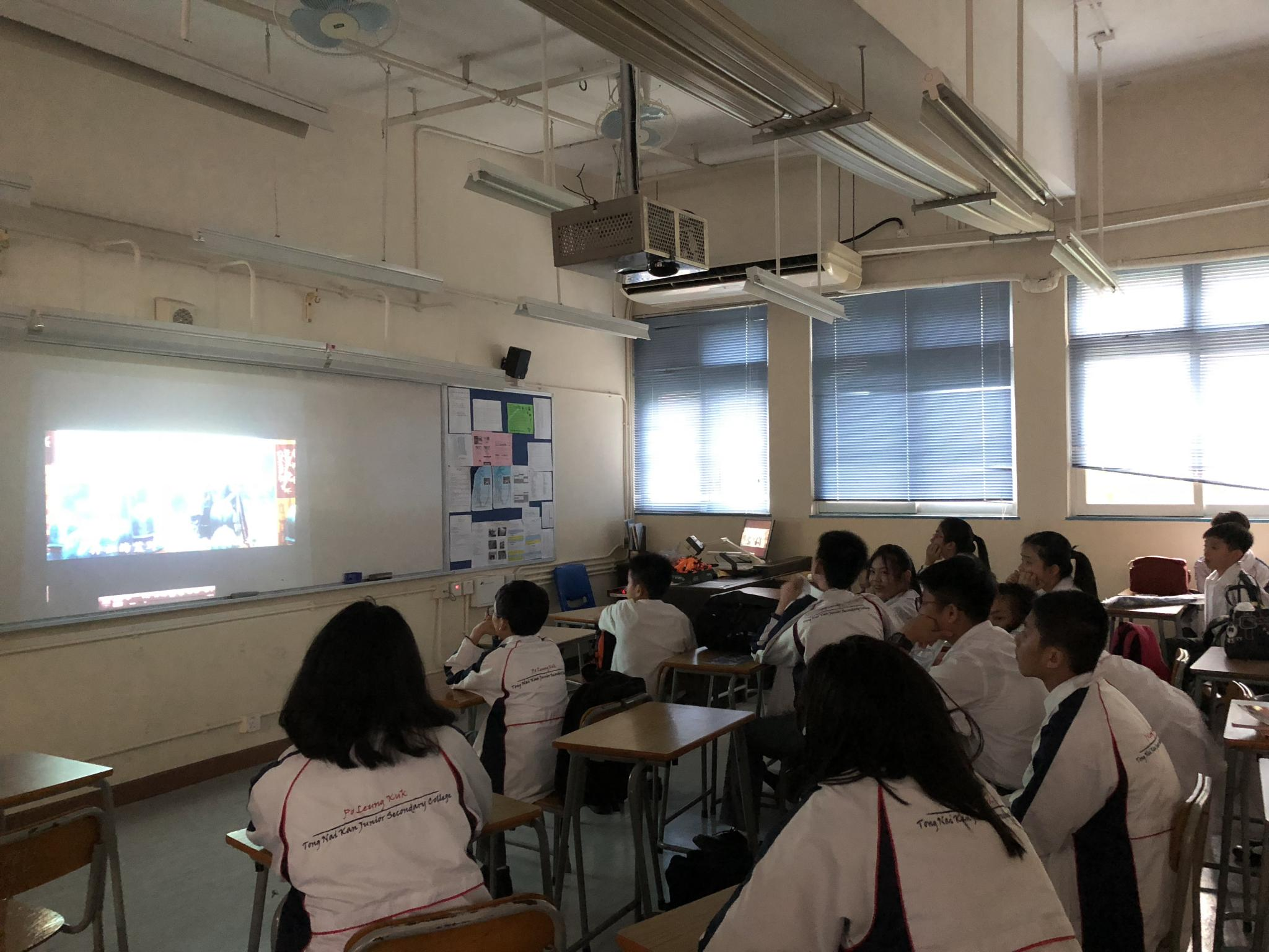 Students were watching the movie 'Maleficent' intently.