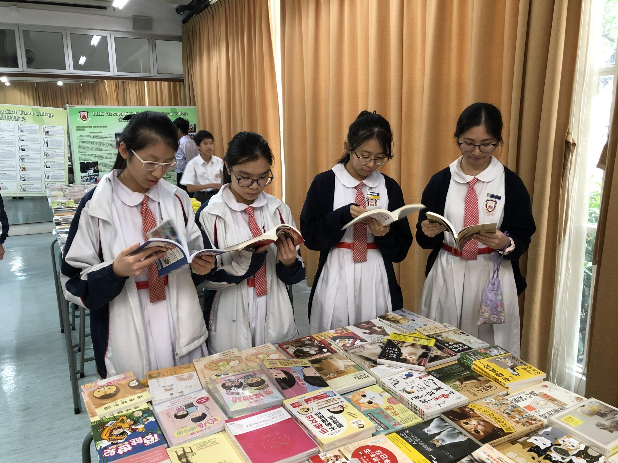 Students are reading their favourite books in the book fair.