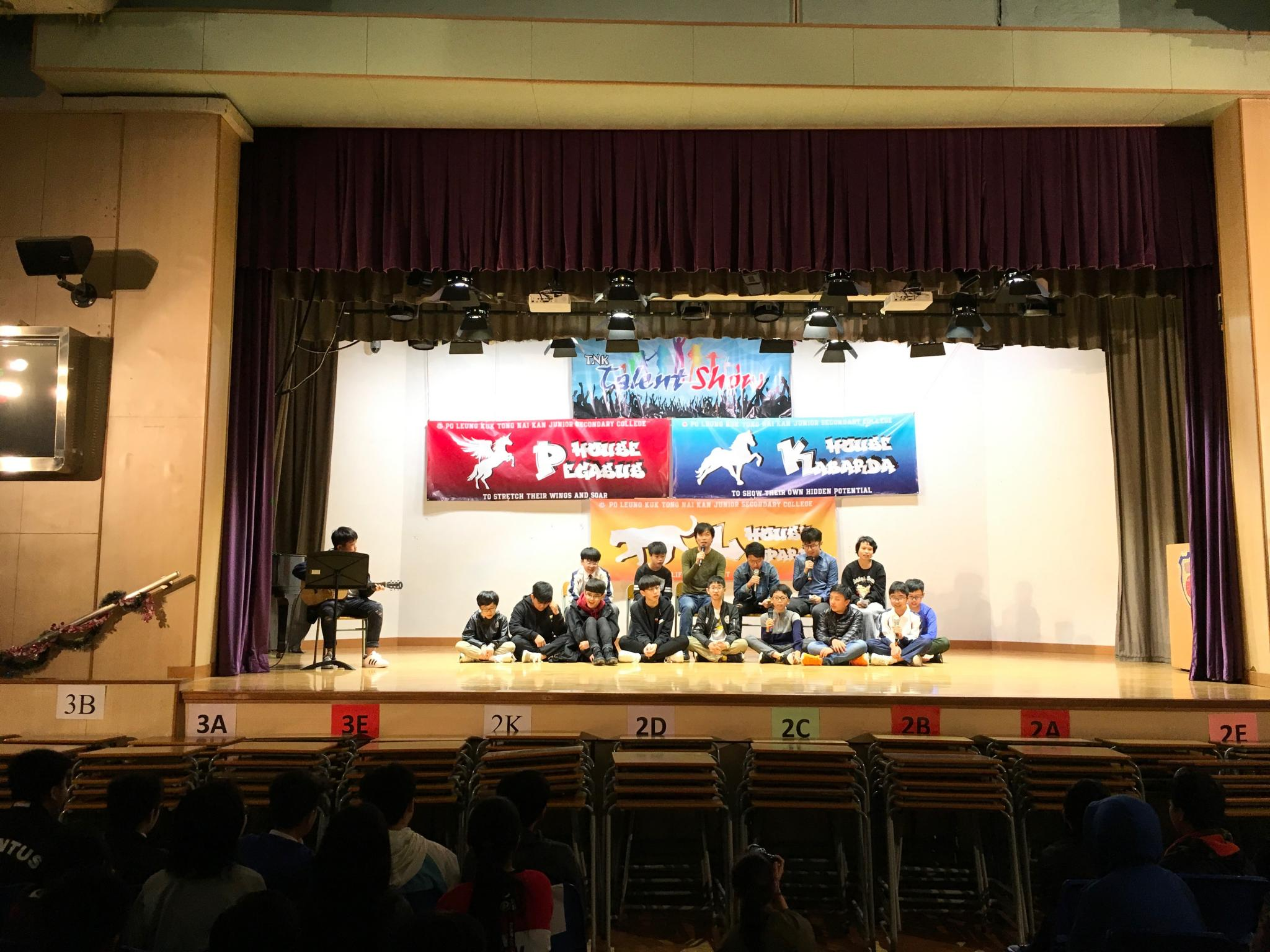 Class 2K was performing a song and one of them was playing the guitar.