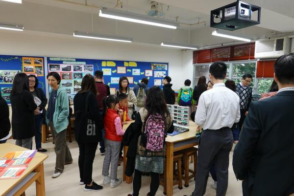 Visitors were curious to students' work and awards.