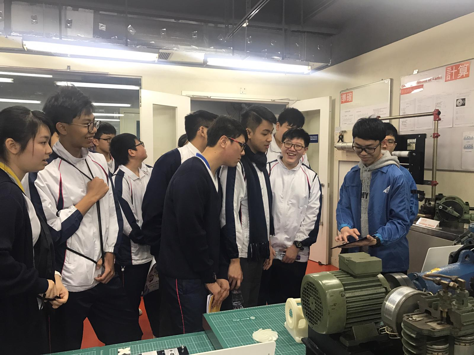 Student helpers of Engineering are showing some demonstration to the students.
