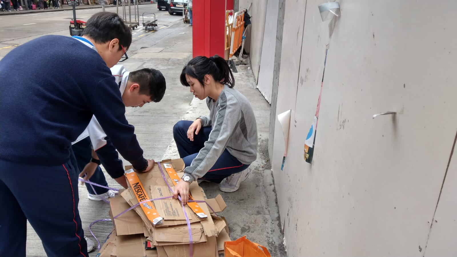Students were tying the collected cardboard.