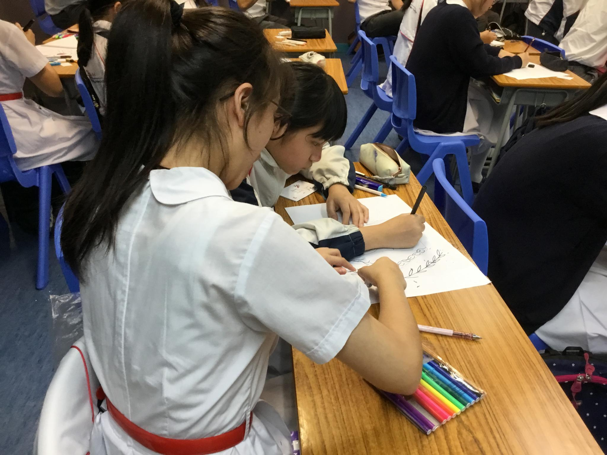 Students were working on the design of the class logo.