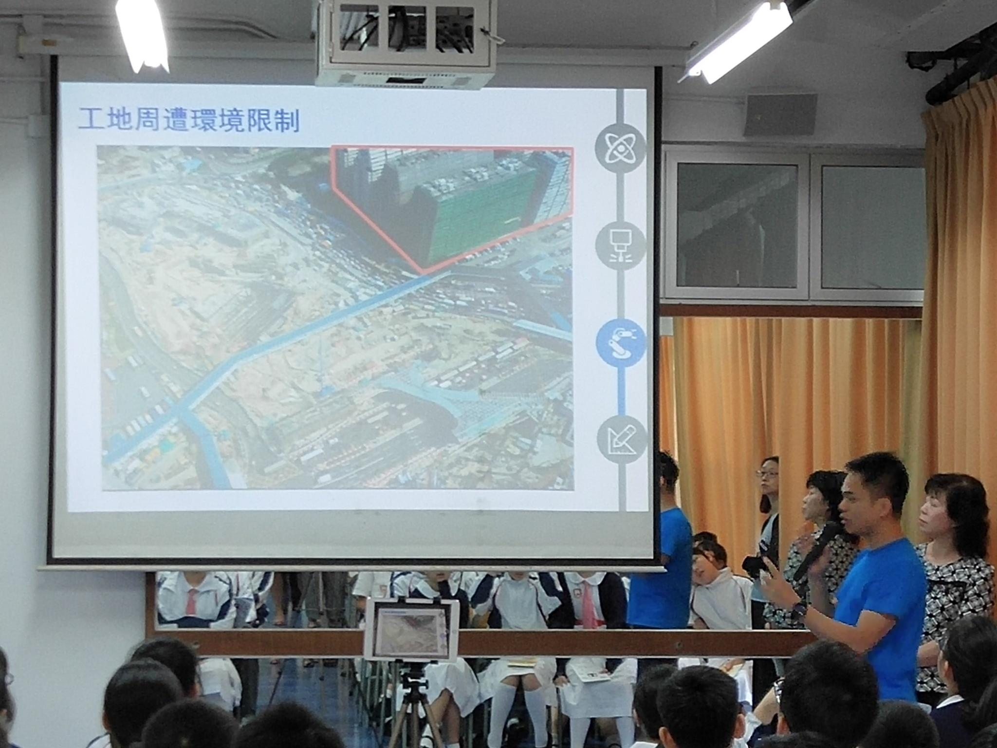 The speaker explained how to consider and tackle the environment contraints in the construction of MTR stations.
