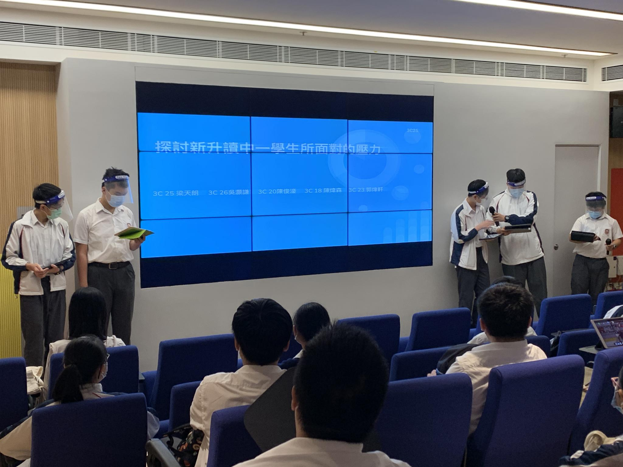 Five S3 students were presenting their ideas about stress faced by S1 students.