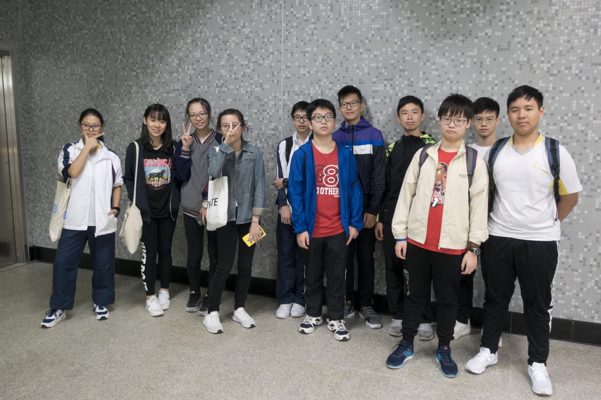 Students assemble at Ho Man Tin MTR station.