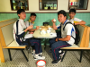 "Students are pretending to ""drink tea"" in an old style Chinese restaurant."